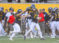 Nov 14, 2020; Morgantown, West Virginia, USA; West Virginia Mountaineers safety Sean Mahone (29) celebrates with teammates after recovering a fumble during the third quarter during the fourth quarter against the TCU Horned Frogs at Mountaineer Field at Milan Puskar Stadium. Mandatory Credit: Ben Queen-USA TODAY Sports
