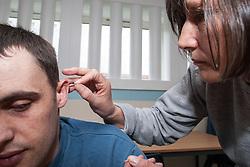 Prisoner receiving acupuncture