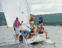 """LWSA Volunteer Warner Nickerson and instructor Parker Tuan take Jack Conaton, Patrick M, Jenna Baumeister, Luke Pongratz and Emma Mannion for a sailing lesson to Bear Island on Nickerson's J80 """"Pressure"""" Wednesday afternoon.   (Karen Bobotas/for the Laconia Daily Sun)Winnipesaukee Yacht Club and Lake Winnipesaukee Sailing Association out on the Lake Wednesday,  July 27, 2011."""
