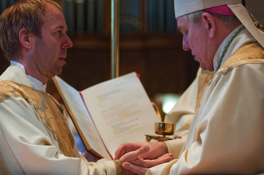 Charles Wrobel's hands are anointed with Chrism by the Archbishop.