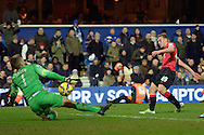 James Wilson of Manchester United shoots to score his team second goal to make it 2-0. Barclays Premier league match, Queens Park Rangers v Manchester Utd at Loftus Road in London on Saturday 17th Jan 2015. pic by John Patrick Fletcher, Andrew Orchard sports photography.