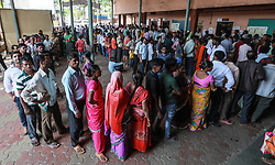 April 29, 2019 - Mumbai, India - Indian voters stand in a queue to cast their votes at a polling station in Mumbai, India,  April 29, 2019. Voting for the fourth phase of India's general elections began on Monday amid tight security, officials said. The highlights of this round in Mumbai, India's financial capital which is home to billionaires and celebrities, besides Rajasthan and Madhya Pradesh, the large swathe of Hindi-speaking India. (Credit Image: © Fariha Farooqui/Xinhua via ZUMA Wire)