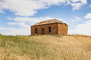 dilapidated old brick farm house in a field near Pallamana, South Australia, Australia <br />