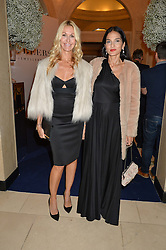 Left to right, MELISSA ODABASH and YASMIN MILLS at the De Beers Moments in Light - a celebration of telented women in association with Women For Women International featuring photographs by Mary McCartney held at Claridge's, Brook Street, London on 18th September 2015.