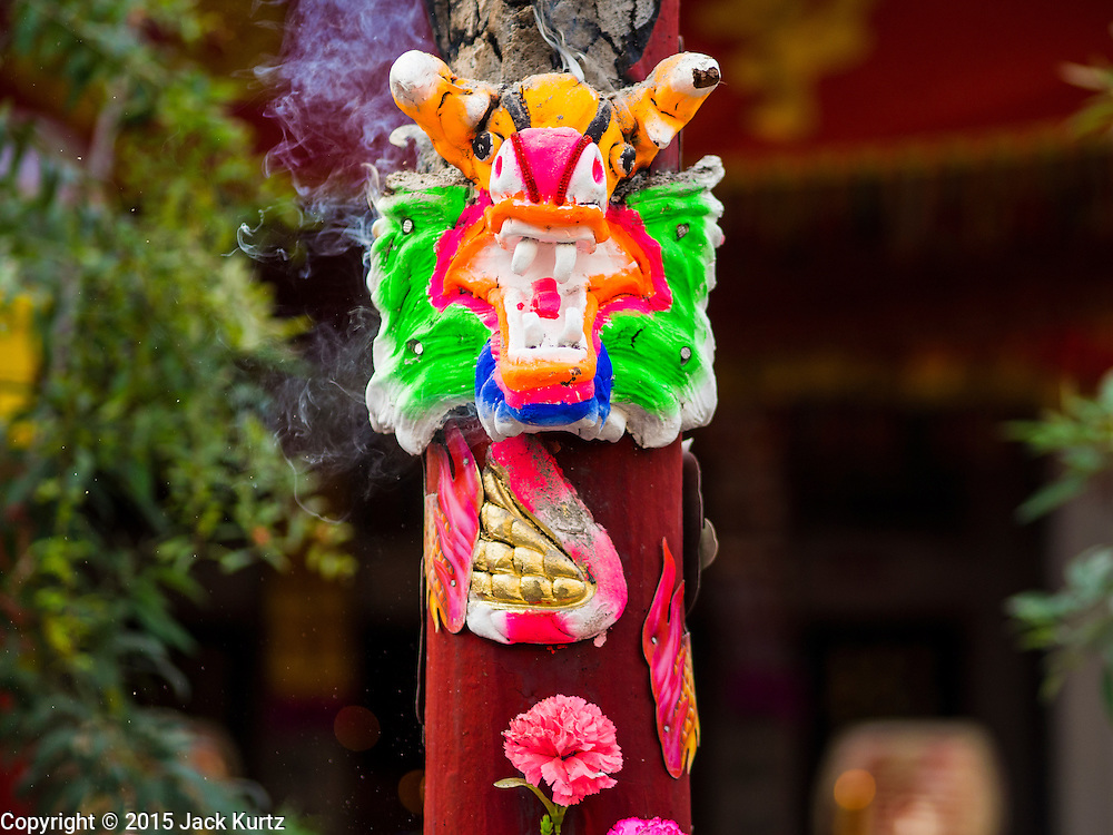 18 JANUARY 2015 - BANGKOK, THAILAND:  A large joss (incense) stick burns in front of the Chaomae Thapthim Shrine during a performance by the Sai Yong Hong Opera Troupe performance. The troupe's nine night performance at the shrine is an annual tradition and is the start of the Lunar New Year celebrations in the neighborhood. The performance is the shrine's way of thanking the Gods for making the year that is ending a successful one. Lunar New Year, also called Chinese New Year, is officially February 19 this year. Teochew opera is a form of Chinese opera that is popular in Thailand and Malaysia.             PHOTO BY JACK KURTZ