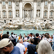 ROME, Italy - Tourists crowd around the Fontana di Trevi (Trevi Fountain) in Rome, Italy.