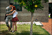 PFC Joe Wafer, a members of A Company, 200th Infantry, New Mexico Army National Guard spends a last quiet moment with his girlfriend Whitney Whetshone. Members of A Company left Thursday for  training at Ft. Dix in New Jersey before deployment to Iraq..