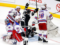 LOS ANGELES, Jan. 22, 2018  Los Angeles Kings' forward Trevor Lewis (C) celebrates after his teammate forward Tanner Pearson (2nd R) scoring against New York Rangers during a 2017-2018 NHL hockey game in Los Angeles, the United States, on Jan. 21, 2018. Los Angeles Kings won 4-2. (Credit Image: © Zhao Hanrong/Xinhua via ZUMA Wire)