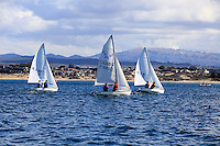 Sailing boats enjoy a day on the water in Monterey Bay, California.