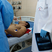 Doctors at Benghazi hospital prepare to preform surgery on a wounded rebel fighter.