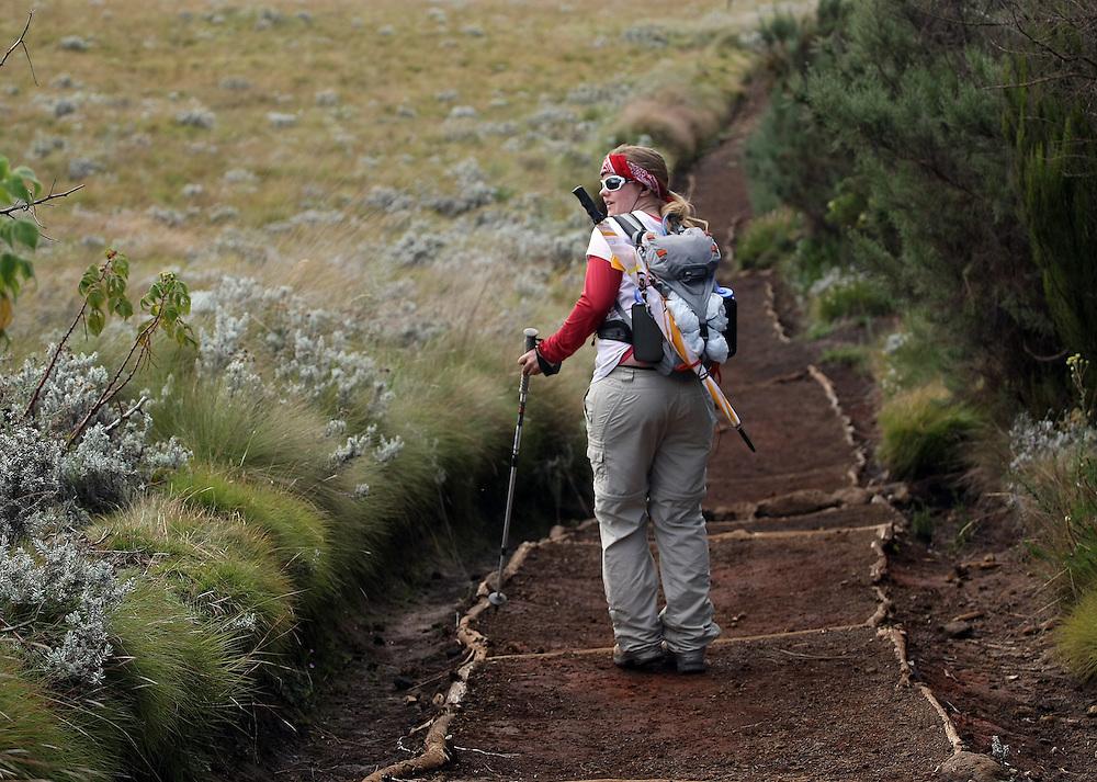 Hannah Berg of Minneapolis finds a rare moment alone as she makes the climb up Mt. Kilimanjaro.