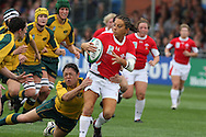 IRB Womens Rugby world cup, day 1 at Surrey university in Guildford.  Wales v Australia.<br /> Non Evans of Wales makes a break