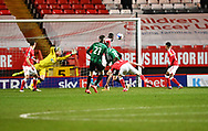Rochdale's Matthew Lund puts his team ahead during the EFL Sky Bet League 1 match between Charlton Athletic and Rochdale at The Valley, London, England on 12 January 2021.