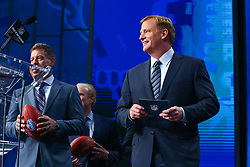 April 26, 2018 - Arlington, TX, U.S. - ARLINGTON, TX - APRIL 26:  NFL Commissioner Roger Goodell walks to the podium with former Dallas Cowboy Quarterback Troy Aikman just prior to the first round of the 2018 NFL Draft at AT&T Statium on April 26, 2018 at AT&T Stadium in Arlington Texas.  (Photo by Rich Graessle/Icon Sportswire) (Credit Image: © Rich Graessle/Icon SMI via ZUMA Press)