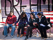 """07 DECEMBER 2010 - PHOENIX, AZ:  DOLORES HUERTA, second from right, joins other DREAM Act protesters in prayer during a fast in front of the offices of US Sen. John McCain Tuesday.  Huerta, who started working in the civil rights movement in the 1960's, threw her support behind students fasting on behalf of the DREAM Act in front of Sen. John McCain's office Tuesday. The student picked McCain's office because he used to support the DREAM Act. They hope that the US Senate will pass the DREAM Act during its """"lame duck"""" session. The Senate debated and defeated similar legislation just before the November general election.  PHOTO BY JACK KURTZ"""