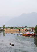 Houseboats and shikaras, local wooden boats, on Lake Dal in Kashmir, India
