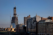 Construction continues to London's latest planned skyscraper, the Shard (aka The Shard of Glass). It is being built on the south side of the city near London Bridge. Shard London Bridge, previously known as London Bridge Tower, and also known as the Shard of Glass. The Shard is a supertall skyscraper under construction in Southwark. When completed in 2012 it will be the tallest building in the European Union.<br /> The tower will stand at 310 m (1,017 ft) tall and have 72 floors, plus 15 further floors in the roof. Renzo Piano, the building's architect, worked together with architectural firm Broadway Malyan during the planning stage of the project. After a lengthy public inquiry, the collaboration successfully achieved its objective, and the developers were granted full planning permission in November 2003.