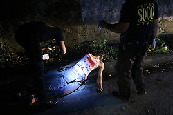 October 8, 2016 - Quezon City, Philippines - (EDITORS NOTE: Image depicts death.) Notorious top number 1 drug dealer Alias Jessie Hudas died during a buy bus operation was conducted by Masambong Quezon City Police officers in West River Side cor Senador st. in Delmonte Quezon City on October 8, 2016. It's part of the total out war campaign by the government about illegal drugs. (Credit Image: © Gregorio B. Dantes Jr/Pacific Press via ZUMA Wire)
