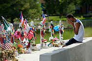 A mourner reacts at a makeshift memorial for victims of the Pulse nightclub shooting outside the Orlando Regional Medical Center, Tuesday, June 28, 2016, in Orlando, Fla. (Phelan M. Ebenhack via AP)