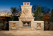 Outdoor patio living area, fireplace with a sunset backdrop in Texas.