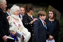 © Licensed to London News Pictures. 18/04/2016. Shirley, UK.  Ronnie Corbett's wife, Anne (left) with other family members leave the funeral of comedian, actor, writer Ronnie Corbett at St John the Evangelist Church in Shirley near Croydon. Corbett, who was most famous for his comedy sketch show  The Two Ronnies, performed with the late Ronnie Barker, died at the age of 85. Photo credit: Ben Cawthra/LNP