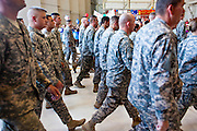 16 JUNE 2010 - PHOENIX, AZ: Returning soldiers march into the hangar at the 161st Air Refueling Wing hangar at Sky Harbor Airport in Phoenix Wednesday. Members of the 3666th Maintenance Company of the Arizona Army National Guard returned to Phoenix Wednesday after serving in Iraq (CQ).    PHOTO BY JACK KURTZ