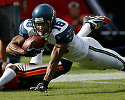 Seattle Seahawks wide receiver D.J. Hackett dives for the end zone during the Seattle Seahawks 23-7 victory over theTampa Bay Buccaneers on December 31, 2006 at Raymond James Stadium in Tampa, Florida.