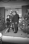22/12/1965<br /> 12/22/1965<br /> 22 December 1965<br /> <br /> Mr. Sean Flanagan T.D.(Parliamentary Secretary to the Minister for Industry and Commerce presenting a bicycle to Mr. Arthur White of Dublin