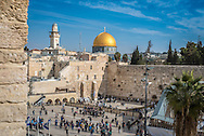 View over the Western Wall with the golden Dome of the Rock in the background, part of the Temple Mount complex. This is one of the holiest sites in the world for all Abrahmic religions.