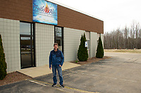 """John Sandborn stands outside of Faith Alive Christian Fellowship building where he will hold """"outside"""" services on Sunday.  (Karen Bobotas/for the Laconia Daily Sun)"""