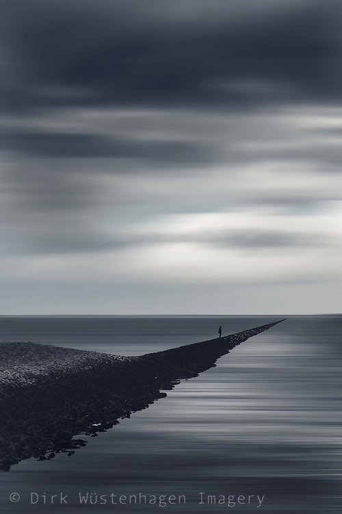 small figure on a levee alone - abstract seascape