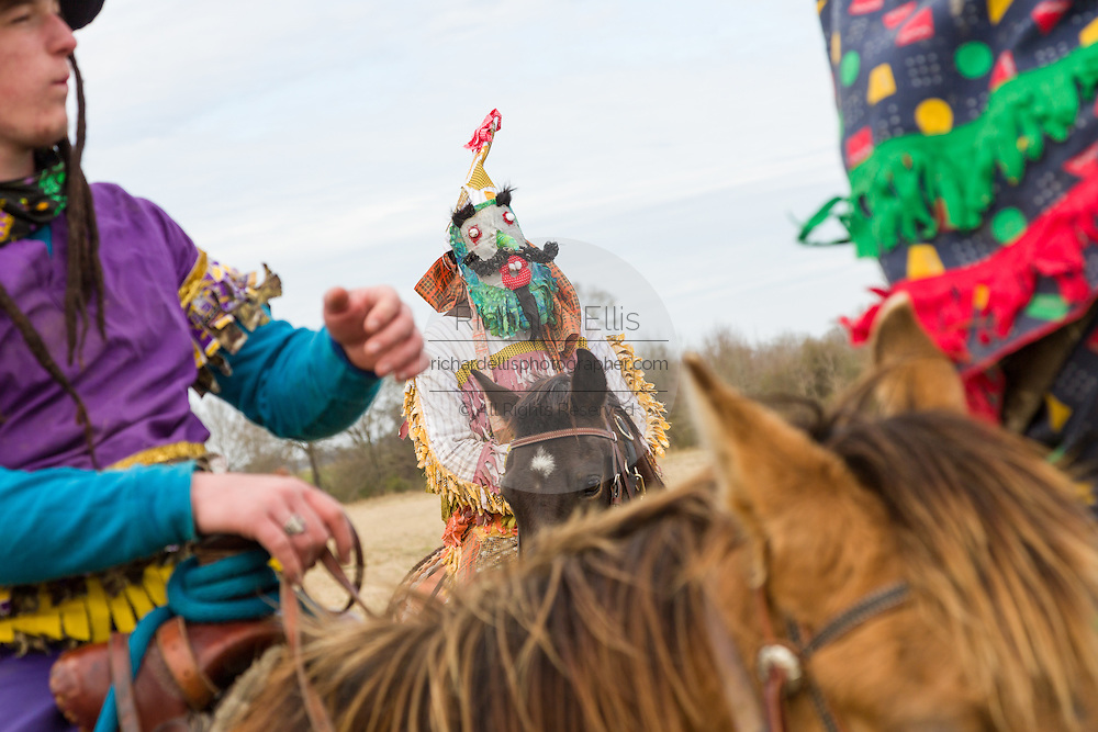 Costumed revelers dance on horseback during the Mamou Courir de Mardi Gras chicken run on Fat Tuesday February 17, 2015 in Mamou, Louisiana. The traditional Cajun Mardi Gras involves costumed revelers competing to catch a live chicken as they move from house to house throughout the rural community.