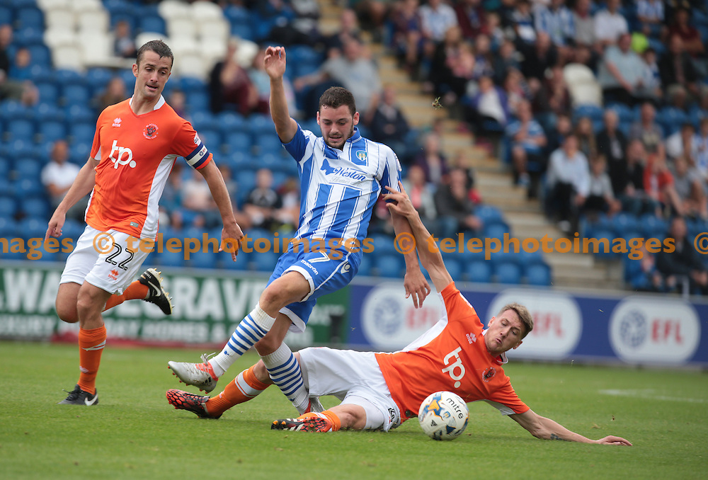 Colchester United's Drey Wright gets tackled by Blackpool's Jim McAlister<br /> during the Sky Bet League 2 match between Colchester United and Blackpool at the Weston Homes Community Stadium in Colchester. September 10, 2016.<br /> James K  Galvin / Telephoto Images<br /> +44 7967 642437