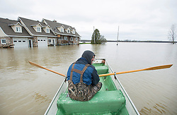 Francois Lussier rows a small boat along a flooded street in the town of Rigaud, Quebec, Canada., west of Montreal, Monday, May 8, 2017, following flooding in the region. Photo by Graham Hughes /The Canadian Press/ABACAPRESS.COM