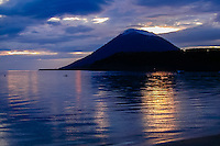 Indonesia, Sulawesi, Bunaken. Manado Tua is a landmark with it's characteristic cone shape, a now extinct volcano. Sunset.