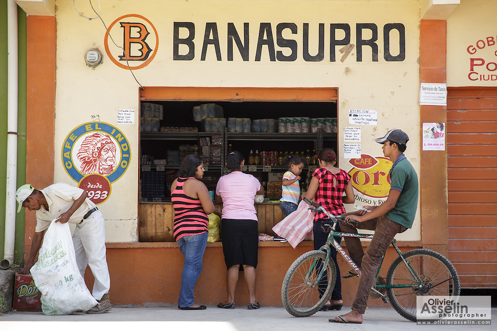 Customers at a shop in the town of San Esteban, Honduras on Wednesday April 24, 2013.