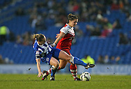 Brighton and Hove Albion Women's midfielder Jay Blackie slide tackles during the FA Women's Premier League match between Brighton Ladies and Charlton Athletic WFC at the American Express Community Stadium, Brighton and Hove, England on 6 December 2015.