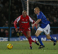 Photo: Dave Linney.<br />Chesterfield v Swindon Town. Coca Cola League 1.<br />28/12/2005.Andy Gurney (Swindon) closes in on  Derek Niven (Chesterfield)