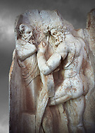 Close up of a Roman Sebasteion relief sculpture of  Herakles is preparing to wrestle the Libyan giant Antaios. Aphrodisias Museum, Aphrodisias, Turkey. Against a grey background.<br /> <br /> Herakles (left) is taking off his bow case to hang it on a pillar statue. Antaios (right) is binding up his head with ear protectors, next to him stands an oil basin used in the palaistra (wrestling ground). Antaios was a famous wrestler who challenged and killed all visitors to his country, until he was defeated by Herakles. .<br /> <br /> If you prefer to buy from our ALAMY STOCK LIBRARY page at https://www.alamy.com/portfolio/paul-williams-funkystock/greco-roman-sculptures.html . Type -    Aphrodisias     - into LOWER SEARCH WITHIN GALLERY box - Refine search by adding a subject, place, background colour, museum etc.<br /> <br /> Visit our ROMAN WORLD PHOTO COLLECTIONS for more photos to download or buy as wall art prints https://funkystock.photoshelter.com/gallery-collection/The-Romans-Art-Artefacts-Antiquities-Historic-Sites-Pictures-Images/C0000r2uLJJo9_s0
