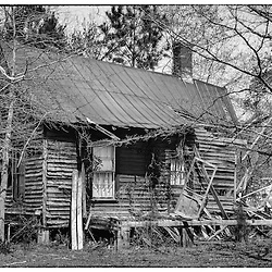 Half of this cabin was splintered by a tornado while the other half seems almost untouched.   Too bad, because it was an interesting old building.