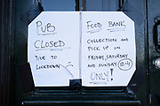 On the last day of the year a pub is closed but food bank collections are still available in Kings Heath as coronavirus restrictions continue on 31st December 2020 in Birmingham, United Kingdom. Small businesses have struggled through the Covid-19 pandemic and many have closed down altogether, as the recession in the economy deepens as the crisis continues.