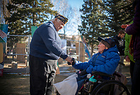American Legion Post 43 member and U.S. Coast Guard veteran Ray Pilgrim, left, shakes hands with World War II veteran Frederick Miles after a Veterans Day ceremony Monday at the Jackson Town Square. See the Valley section of tomorrow's Jackson Hole News&Guide for coverage of Veterans Day events around the valley.