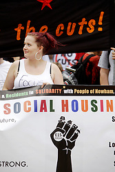 Newham, London. 05/07/2014<br /> Sam Middleton, one of the Focus E15 Mothers, leads a protest through Newham. The Focus E15 Mothers campaign is a group of young single mothers who were placed into temporary accommodation by Newham council, after being evicted from council housing, but were warned they could be re-housed as far away as Birmingham, Manchester and Hastings. Some mothers have already relocated outside of London due to the lack of affordable social housing.<br /> Photo: Anna Branthwaite/LNP