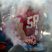 Steve Graves of Warsaw, Mo., grilled hamburgers while tailgating prior to the game between the Kansas City Chiefs and the Denver Broncos on Thursday, September 17, 2015 at Arrowhead Stadium in Kansas City, Mo.