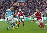 Football - 2018 Carabao (EFL/League) Cup Final - Manchester City vs. Arsenal<br /> <br /> Vincent Kompany (Manchester City) clears in front of an on rushing Pierre-Emerick Aubameyang (Arsenal FC) at Wembley.<br /> <br /> COLORSPORT/DANIEL BEARHAM