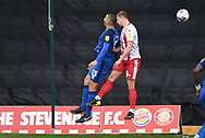 Carlisle United defender Rob McDonald (13) and Stevenage forward Luke Norris (36) clash heads during the EFL Sky Bet League 2 match between Stevenage and Carlisle United at the Lamex Stadium, Stevenage, England on 20 March 2021.