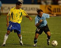 Fotball<br />19/11/03 - WORLD CUP QUALIFYING 2006<br />BRASIL (3) VS. URUGUAY (3) - Curitiba - Brasil.<br />A World Cup Qualifying match played between the National football team of Brasil and Uruguay in Curitiba, Brasil. <br />Nunez  (Uruguay) and  Renato  (Brasil)<br />Foto: Digitalsport