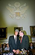 Federal Reserve Chairman Alan Greenspan talks with Secretary of the Treasury Robert Rubin before the start of House Banking hearings May 20, 1999 in Washington, DC.