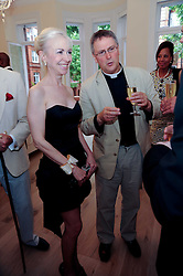 LADY BIENVENIDA BUCK and FR.MICHAEL SEED at a reception to celebrate the repairs on the Queen Elizabeth Gate in Hyde Park after it's successful repair following damaged sustained in a traffic accident in early 2010.  The party was held at 35 Sloane Gardens, London on 7th June 2010.