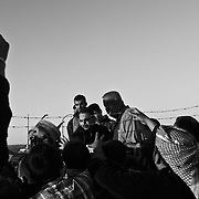 Residents fleeing Mosul wait to receive aid at a camp for Internally Displaced People inKhazir Camp in Northern Iraq.